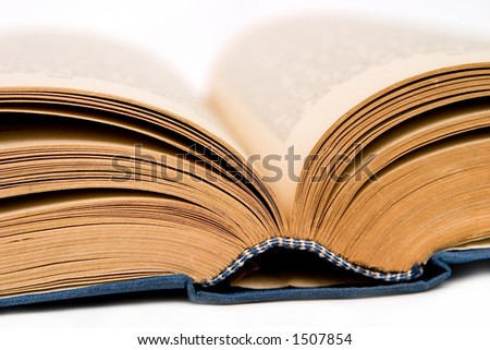 Closeup of opened book on white background