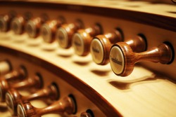 Closeup of organ knobs used for changing the voice of pipe organ sound. (very selective focus of depth)