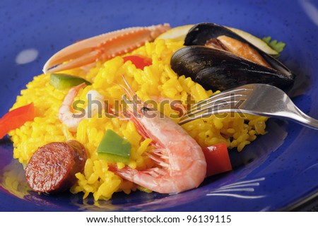 Closeup of paella on blue plate