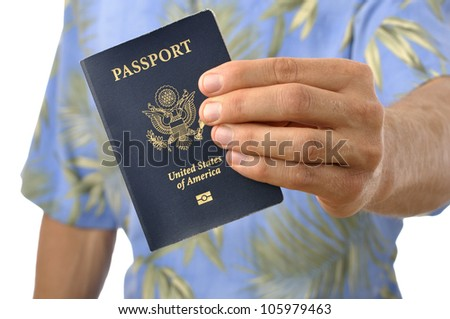 Closeup of passport held by unrecognizable male tourist
