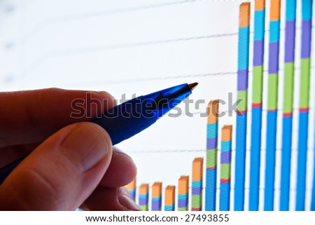 closeup of pen showing graph on screen