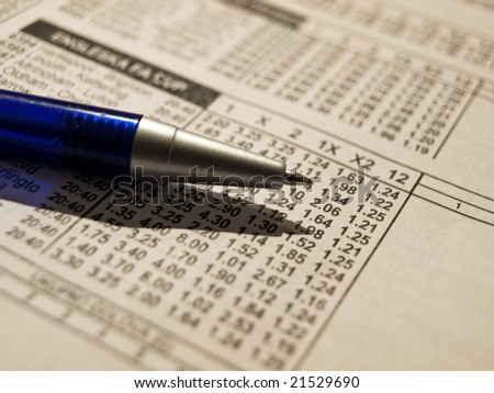 Closeup of pencil on a betting wager's list.