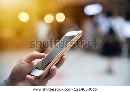 Closeup of people hand working online in mobile with blurred city light on the street background. Modern wireless connection technology for lifestyle and business. Network connection and communication #1214850865