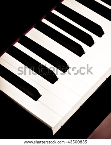 Closeup of Piano keys in high contrast black and white. Shown are black keys and white keys. Background room for text