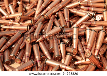 closeup of pictures, piles of rifle bullets