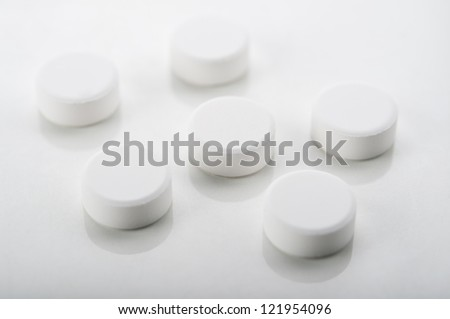 closeup of pills on white background #121954096