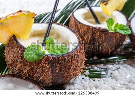 Closeup of pinacolada drink in the fresh coconut