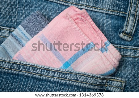 closeup of pink fabric hanky in blue jeans pocket  Stock photo ©
