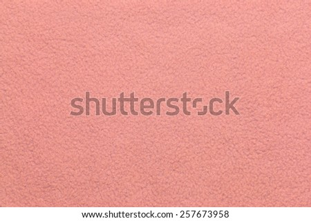 Closeup of pink plush or wool texture useful as background #257673958