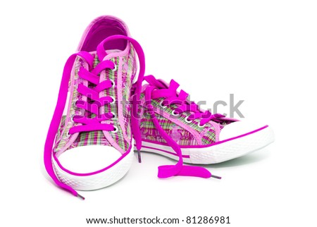 Closeup of pink sneakers with shoelaces isolated on white background
