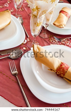 closeup of place setting with dark red napron