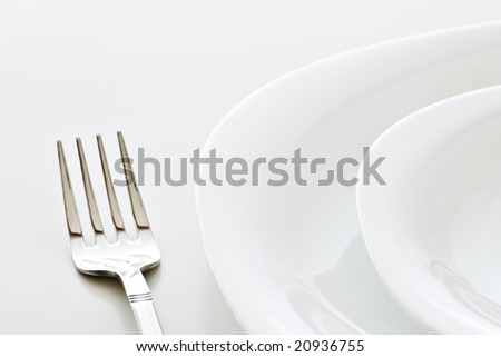 closeup of place setting with plates and fork