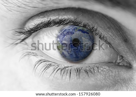 Closeup of planet Earth in human eye. Elements of this image furnished by NASA.