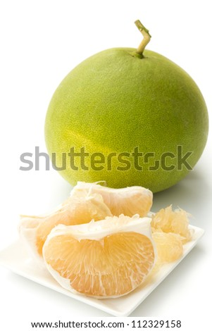 Closeup of pomelo isolated on white background