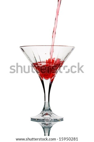 Closeup of pouring a red cocktail into glass