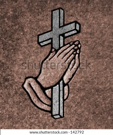 closeup of praying hands holding a cross on a granite gravestone