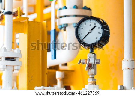 Closeup of pressure gauge,pressure gauge measuring gas pressure. Pipes and valves at oil and gas  industrial plant.