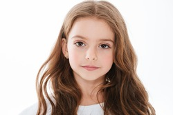 Closeup of pretty cute little girl with long hair over white background