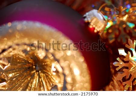 Closeup of purple christmas tree glass ball. Shallow dof, focus on the snowflake.