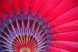 Closeup of red bamboo paper umbrella structure, traditional wooden umbrella in northern of Thailand