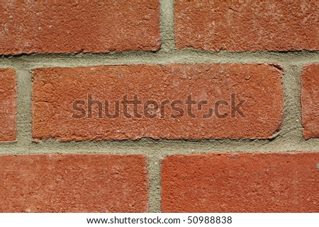 Closeup of red brick wall suitable as background.
