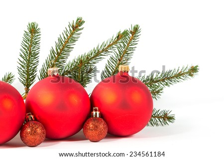 Closeup of red Christmas balls and fir branch on white background. #234561184