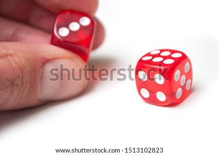 Closeup of red dice in hand on white background #1513102823