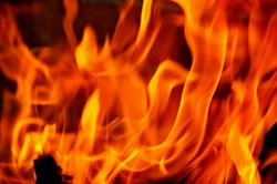 closeup of red fire flames of a fireplace