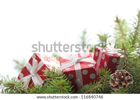 Closeup of Red gift boxes on pine branch,copy space for your text.