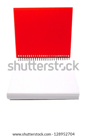closeup of red spiral notebook isolated on white background