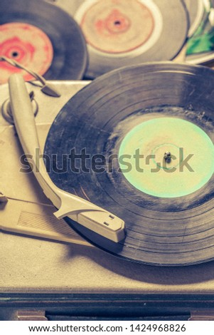 Closeup of retro record player and stack of vinyl records #1424968826