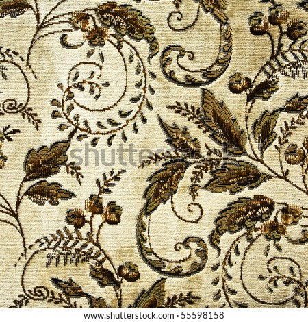 Closeup of retro tapestry fabric pattern with classical floral graphical  ornament  in brown tones on light-beige background.