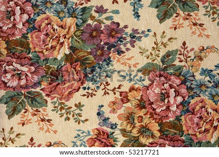 Closeup of retro tapestry fabric pattern with classical image of the colorful  floral ornament.