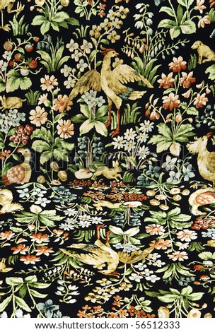 Closeup of retro tapestry fabric pattern with classical image of the colorful  flowers, birds and hares on black background.Vertical and horisontal surface together