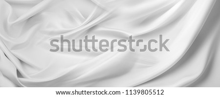 Closeup of rippled white silk fabric #1139805512