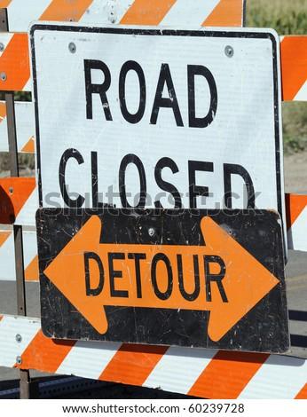detour road sign. closed and detour signs