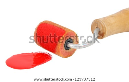 Closeup of roller applying bright red paint, isolated on a white background