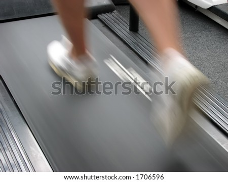 Closeup of running man using treadmill. Business concepts: determiniation, go-getter, leadership, stamina etc.