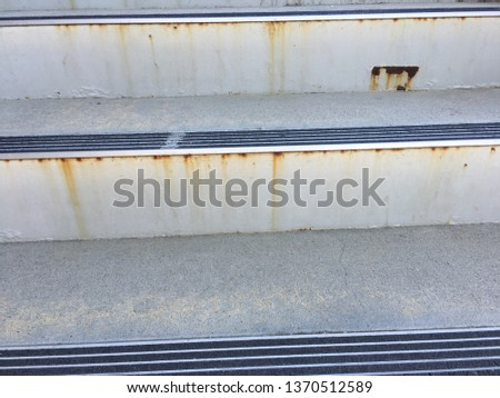 Closeup of rusting metal stairs. #1370512589