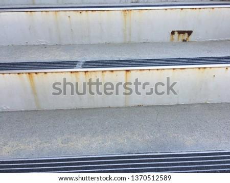 Closeup of rusting metal stairs. #1370512589