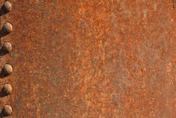 Closeup of rusty metal with knobs