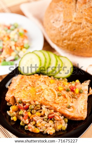 Closeup of salmon fillets served with vegetables garnish - stock photo