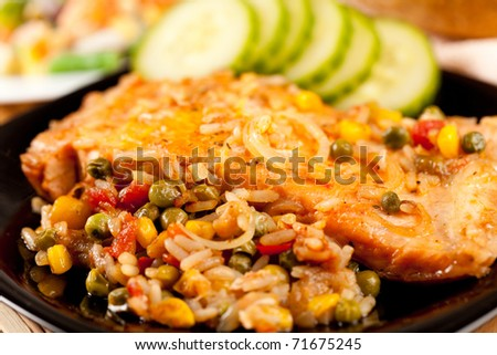 Closeup of salmon fillets served with vegetables garnish
