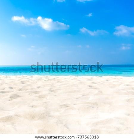 Closeup of sand on beach and blue summer sky