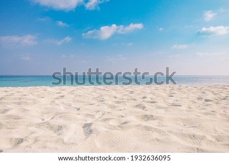 Closeup of sand on beach and blue summer sky. Panoramic beach landscape. Empty tropical beach and seascape. Orange and golden sunset sky, soft sand, calmness, tranquil relaxing sunlight, summer mood