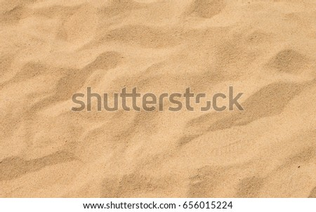 closeup of sand pattern of a beach in the summer #656015224