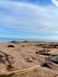 Closeup of Sand, Pebbles and Pine Needle on the Lake Superior Shoreline with Soft Focus Background