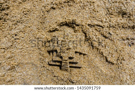 Closeup of sand pyramid. Shallow depth of field, soft focus, selective focus. #1435091759
