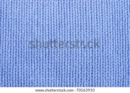 closeup of seamless blue knitted fabric texture