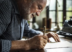 Closeup of senior man writing letter
